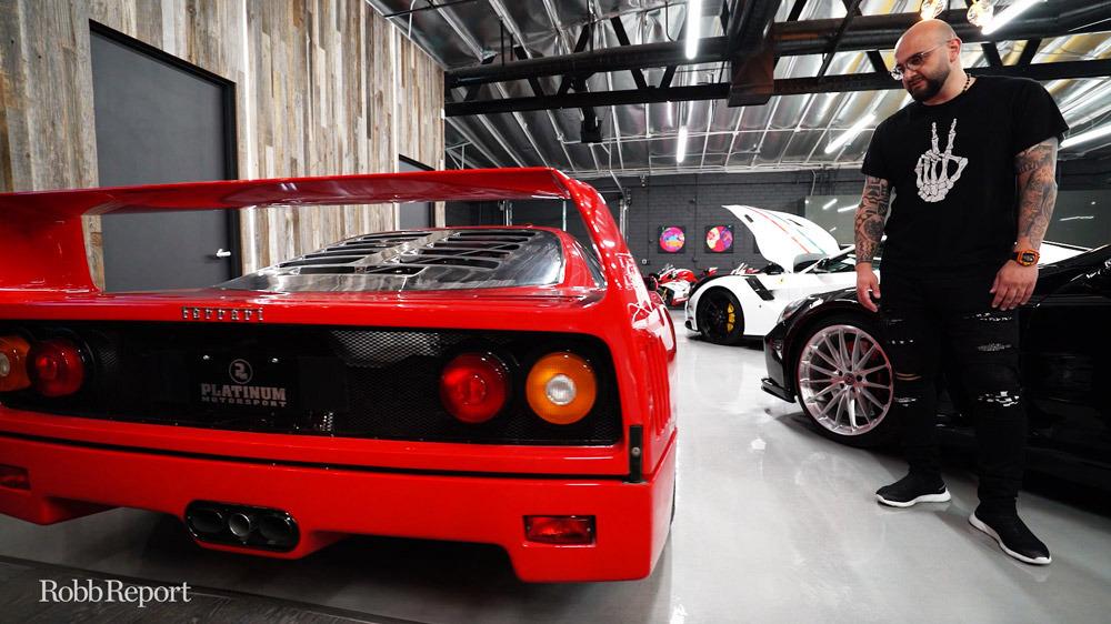 Edvin Ovasapyan admiring his Ferrari F40.